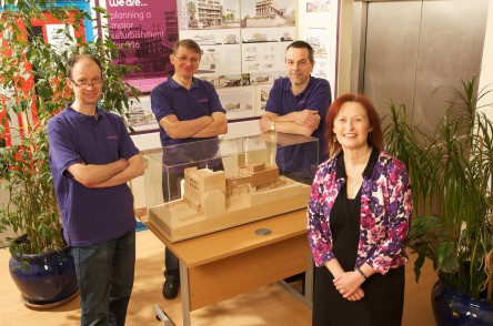 Manager and trustees with model of new building